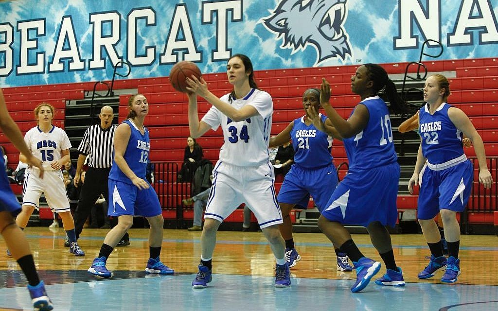 In this Nov. 24, 2013 loss to the College of Elizabeth, Yeshiva University Maccabees forward Rebecca Yoshor, No. 34, grabbed 22 rebounds, a category in which she leads the nation. (Courtesy of Yeshiva University Sports Information Office/JTA)