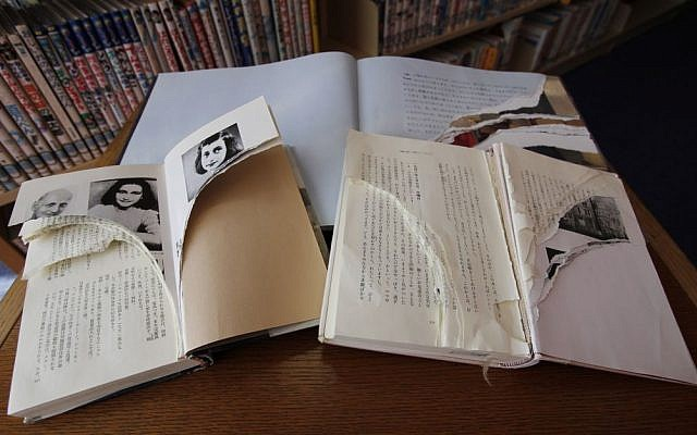 Ripped copies of Anne Frank's 'Diary of a Young Girl' and related books are shown at Shinjuku City Library in Tokyo, on Friday, February 21, 2014. (AP/Koji Ueda)