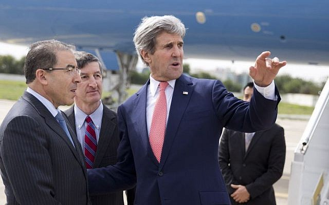 US Secretary of State John Kerry, right, talks with Tunisian Foreign Minister Mongi Hamdi, left, and ambassador Jake Walles after arriving at El Aouina Air Base Tuesday, February 18, 2014, in Tunis (photo credit: AP/Evan Vucci, Pool)