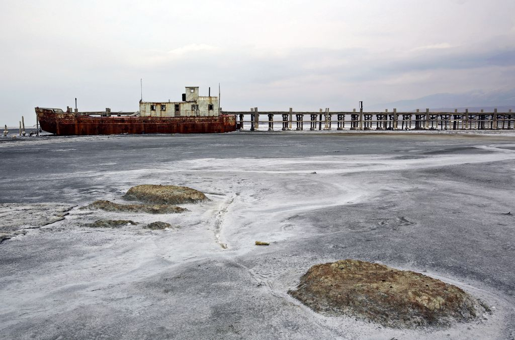 In this Sunday, Feb. 16, 2014 photo, an abandoned ship is stuck in solidified salt at Lake Oroumieh, northwestern Iran. Oroumieh, one of the biggest saltwater lakes on Earth, has shrunk more than 80 percent to 1,000 square kilometers (nearly 400 square miles) in the past decade, mainly because of climate change, expanded irrigation for surrounding farms and the damming of rivers that feed the body of water, experts say. (photo credit: AP Photo/Ebrahim Noroozi)