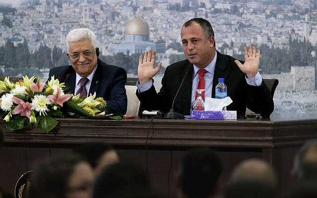 Mahmoud Abbas (l) and MK Hilik Bar at the Muqataa in Ramallah, February 16, 2014 (photo credit: AP/Nasser Nasser)