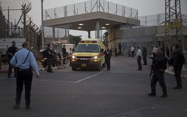 Illustrative: An ambulance leaves Rimonim Prison while Israeli police SWAT teams enter the prison, on Sunday, February 23, 2014. (AP/Ariel Schalit)