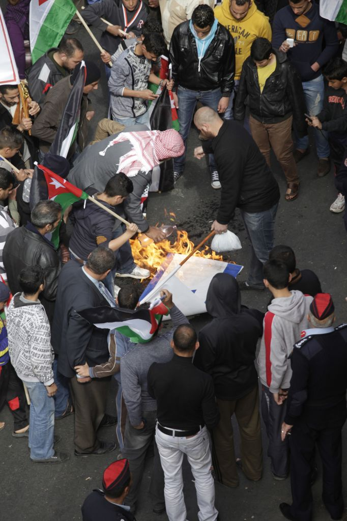 Jordanian protesters burn an Israeli flag during a demonstration in downtown Amman, Jordan, on Friday (photo credit: AP/Mohammad Hannon)