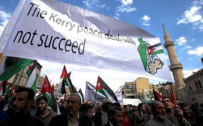 Illustrative photo of protesters affiliated with Jordan's Muslim Brotherhood chanting anti-Israel and anti-America slogans during a demonstration in downtown Amman, Jordan, February 2014. (photo credit: AP/Mohammad Hannon)