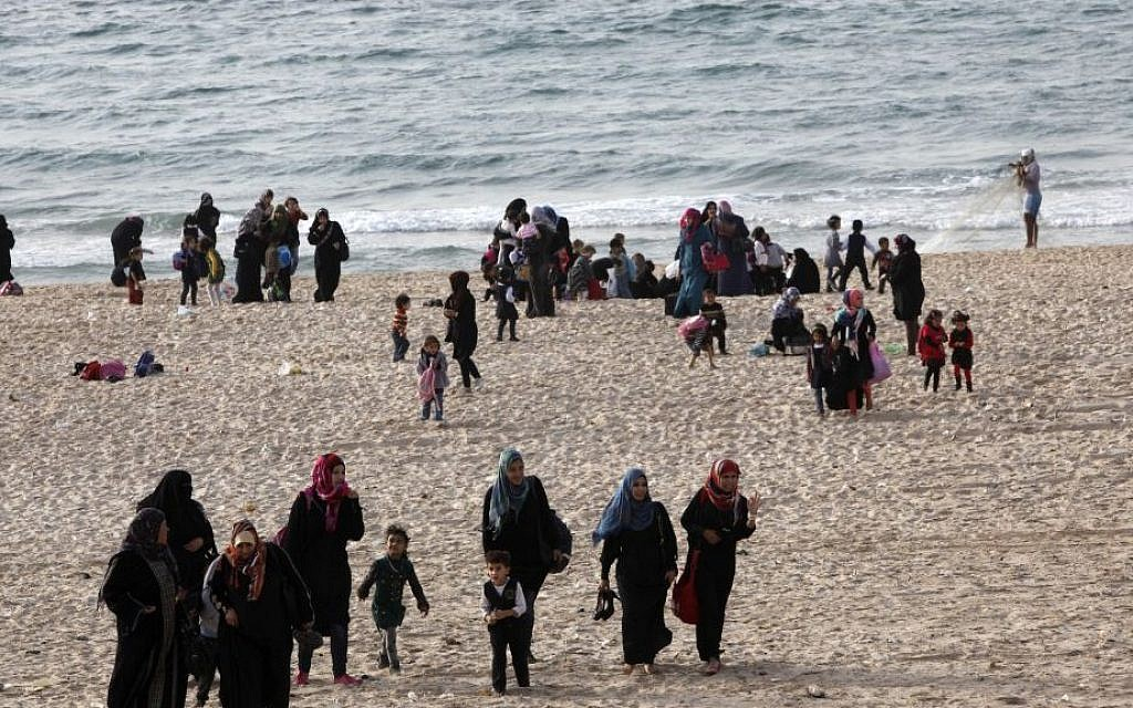 Palestinian families enjoy the beach in Gaza City, Gaza, Oct. 31. 2013 (photo credit: AP/Adel Hana)