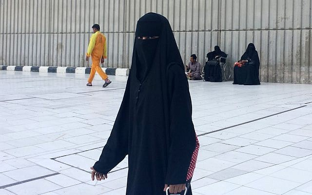 A veiled woman walks in Mecca, Saudi Arabia.(photo credit: AP Photo/Aya Batrawy, File)