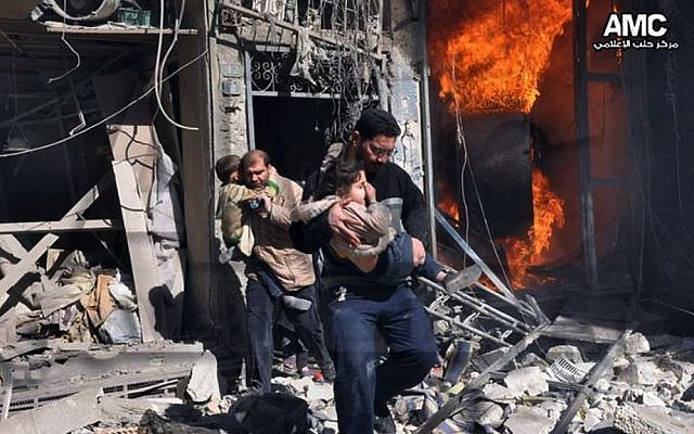 Syrian men help survivors out of a destroyed building after government warplanes attack Aleppo, Syria, on Feb. 8, 2014. (photo credit: AP/Aleppo Media Center AMC)
