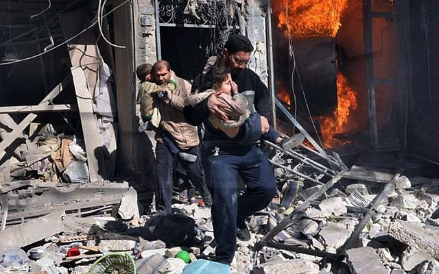 Syrian men help survivors out of a destroyed building after a Syrian forces warplane's attack in Aleppo, Syria, on Saturday, February 8, 2014. (photo credit: AP Photo/Aleppo Media Center)