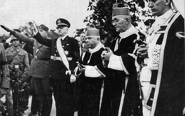 Croatian Parliament president Marko Došen giving Nazi salute (far left) accompanied by Archbishop Alojzije Stepinac (far right) and other Catholic Church leaders. (public domain via wikipedia)