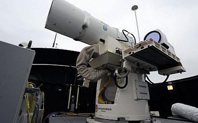 A laser weapon sits temporarily installed aboard the guided-missile destroyer USS Dewey in San Diego. The Navy plans to deploy its first laser on a ship in 2014, and intends to test an electromagnetic rail gun prototype aboard a vessel within the following two years. (photo credit: AP Photo/U.S. Navy, John F. Williams)