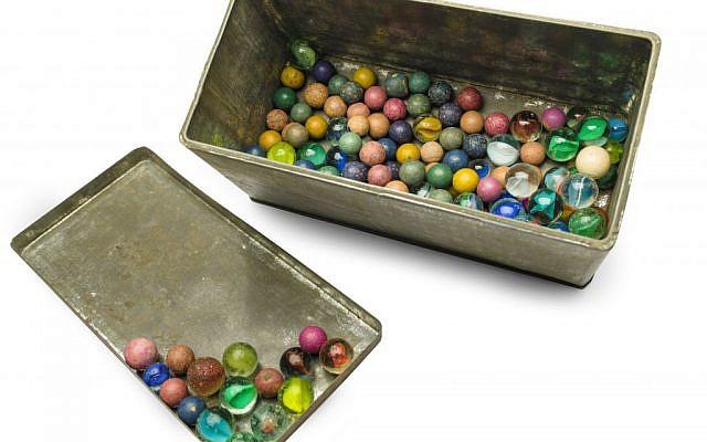A set of marbles belonging to Anne Frank,  November 14, 2013 (photo credit: AP Photo/Anne Frank House Amsterdam, Diederik Schiebergen)