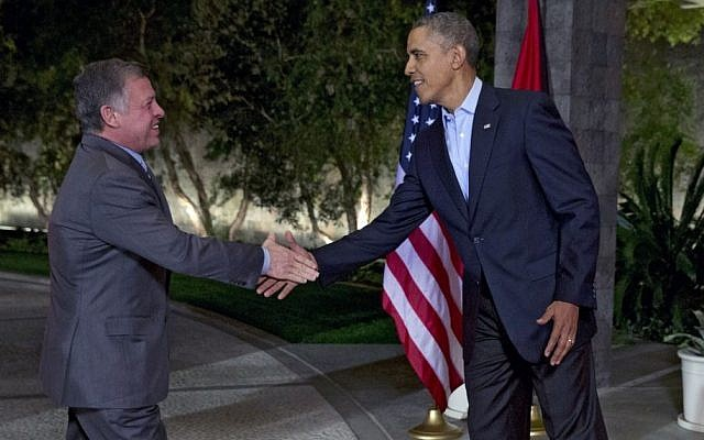 US President Barack Obama greets Jordan's King Abdullah II at The Annenberg Retreat at Sunnylands, Rancho Mirage, California, on Feb. 14, 2014. (photo credit: AP/Jacquelyn Martin)