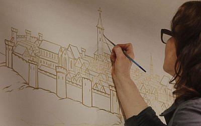 Monika Czerniec, art restoration expert, paints elaborate wall paintings that tell the story of Poland's Jewish community at the new Museum of the History of Polish Jews in Warsaw, Poland, Monday, Feb. 17, 2014. (AP Photo/Czarek Sokolowski)