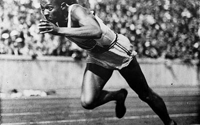 In this 1936 photo, American Jesse Owens runs in a 200-meter preliminary heat at the Summer Olympics in Berlin. Owens won four gold medals at the games, and showed up Adolph Hitler's idea of Aryan supremacy.  (AP Photo/File)