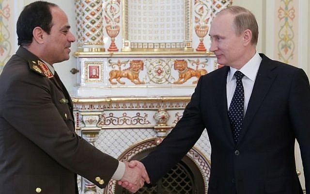 Russian President Vladimir Putin, right, shakes hands with Egypt's Military chief Field Marshal Abdel-Fattah el-Sissi in the Novo-Ogaryovo residence outside Moscow on Thursday, Feb. 13, 2014. (Photo credit: AP Photo/RIA Novosti, Mikhail Metzel, Presidential Press Service)