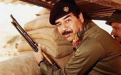 Saddam Hussein during Iran-Iraqi war in the 1980s. (photo credit: Wikimedia Commons/AFP/Getty Images public domain)