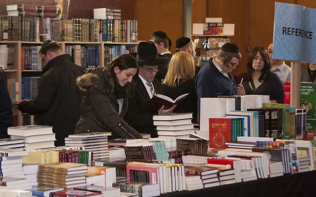 Visitors search for treasures at the Yeshiva University's annaul Seforim Sale. (courtesy)