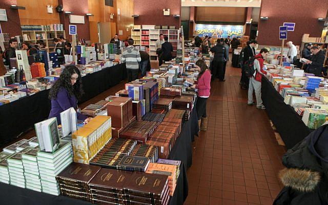 Piles of books at the annual Seforim Sale at Yeshiva University. (courtesy)