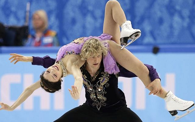 Meryl Davis and Charlie White of the United States compete in the ice dance free dance figure skating finals at the Iceberg Skating Palace in Sochi, Russia, on Monday (photo credit: AP/Darron Cummings)