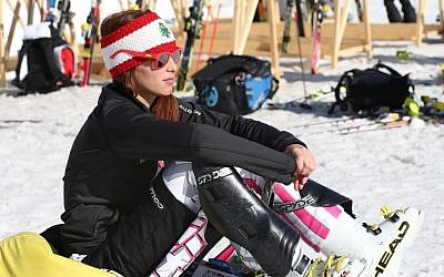 Lebanon's Jacky Chamoun sits near the alpine ski course finish area at the Sochi 2014 Winter Olympics, Thursday, Feb. 13, 2014, in Krasnaya Polyana, Russia. (AP Photo/Luca Bruno)