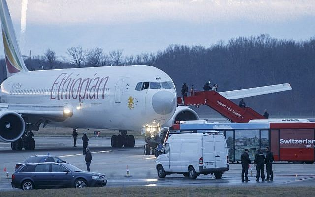 Passengers are evacuated from a hijacked Ethiopian Airlines plane at Geneva International Airport, in Switzerland on Monday (photo credit: AP/Keystone/ Salvatore Di Nolfi)