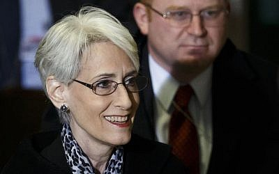 United States Under Secretary of State for Political Affairs Wendy Sherman, left, arrives for a trilateral meeting with UN-Arab League envoy for Syria Lakhdar Brahimi and Russian Deputy Minister of Foreign Affairs Gennady Gatilov (not pictured) during the second round of negotiations between the Syrian government and the opposition at the European headquarters of the United Nations, in Geneva, Switzerland, Thursday, Feb. 13, 2014. (photo credit: AP/Keystone, Valentin Flauraud)