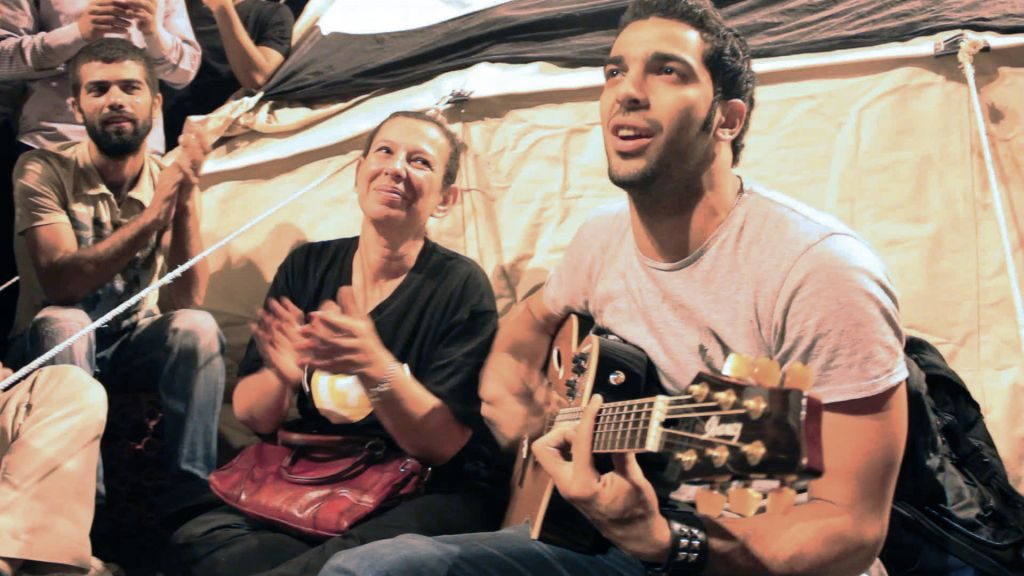 "Egyptian activist Ramy Essam (R) in Jehane Noujaim's documentary ""The Square."" (Photo credit: courtesy of Noujaim Films."