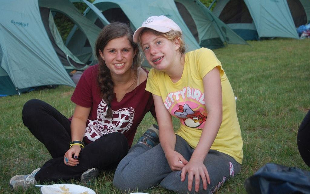 A child with disabilities hangs out with a peer at Camp Ramah Wisconsin. The Ramah camps were among the first Jewish camps to include children with disabilities. (Courtesy National Ramah Commission/JTA)