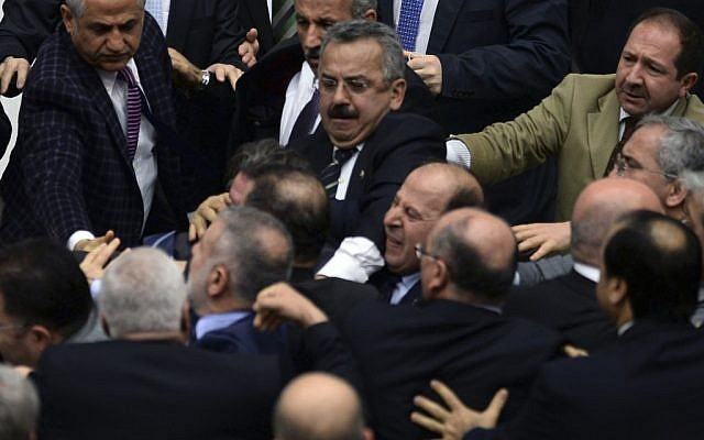 Turkish legislators from Prime Minister Recep Tayyip Erdogan's ruling party and the main opposition Republican People's Party brawl during a tense all-night debate over a controversial law on changes to a council that appoints and oversees judges and prosecutors, in Ankara, early Saturday, Feb. 15, 2014 (photo credit: AP)