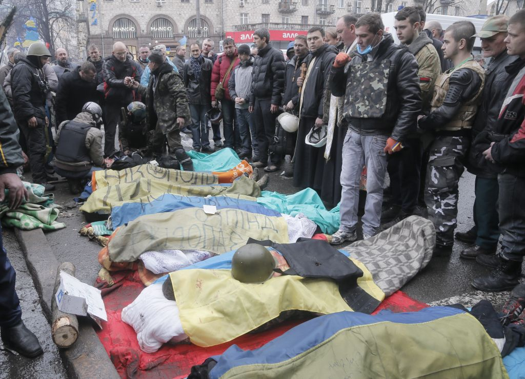 Activists pay respects to protesters who were killed in clashes with police in Kiev's Independence Square, the epicenter of the country's current unrest, Kiev, Ukraine, Thursday, February 20, 2014 (photo credit: AP/Efrem Lukatsky)