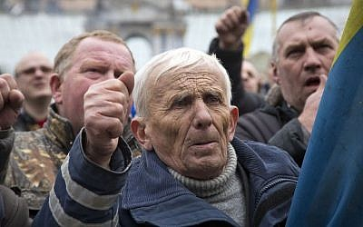 Men shout slogans during mourning for protesters killed in recent clashes, in central Kiev, Ukraine on Saturday. (photo credit: AP/Darko Bandic)