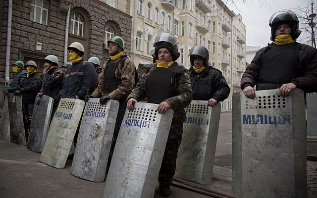 Protesters stand guard in front of presidential administrative building in central Kiev, Ukraine, on Saturday, February 22, 2014.  (photo credit: AP/Darko Bandic)