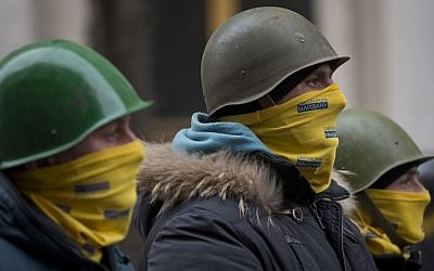 Protesters stand guard in front of presidential administrative building in central Kiev, Ukraine on Saturday. (photo credit: AP Photo/Darko Bandic)