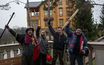 Protesters pose in front of Victor Yanukovych's countryside residence in Mezhyhirya, Ukraine, Saturday, Feb, 22, 2014. (photo credit: AP/Andrew Lubimov)