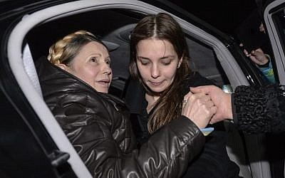 Former Ukrainian prime minister Yulia Tymoshenko, being helped out of her car by her daughter Eugenia, right, upon her arrival to Kiev's iconic Independence Square following her surprise release from prison. (photo credit: AP Photo/ Andrew Kravchenko)