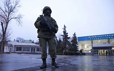 An unidentified armed man patrols a square in front of the airport in Simferopol, Ukraine, on Friday, Feb. 28, 2014 (photo credit: AP/Ivan Sekretarev)