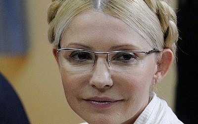 In this 2011 file photo former Ukrainian prime minister Yulia Tymoshenko sits during a trial hearing at the Pecherskiy District Court in Kiev. (photo credit: AP Photo/Sergei Chuzavkov, File)
