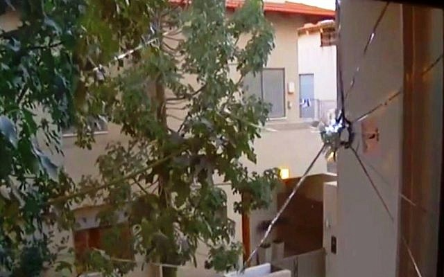 A view from the pierced window of Akim's hostel in northern Tel Aviv (Photo credit: YouTube screen capture)