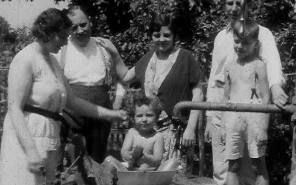 Relatives give little Bobby Schneider a bath in the Hungarian countryside c. 1940. (courtesy of Lynn Schneider)