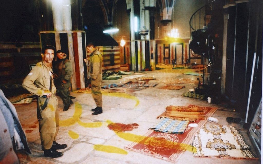 Israeli soldiers stand next to blood stains on the floor of Yitzhak Hall in the Tomb of the Patriarchs following the Goldstein massacre, February 25, 1994. (photo credit: Flash90)