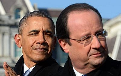 US President Barack Obama and French President Francois Hollande during a welcoming ceremony on the South Lawn of the White House in Washington, on February 11, 2014 (photo credit: AFP/Jewel Samad)