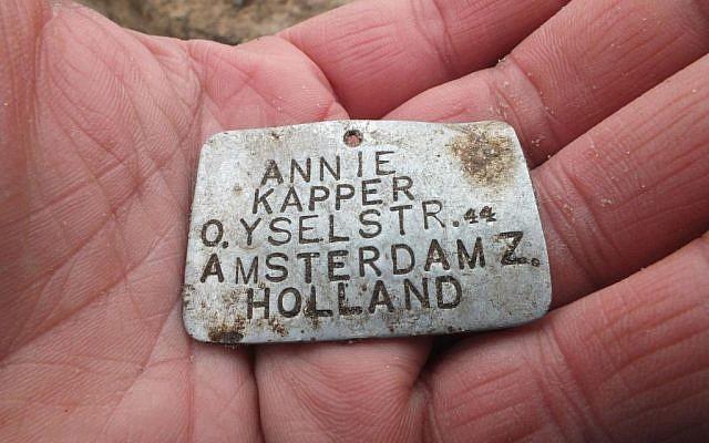 Metal nameplate of murdered Jewish Dutch girl, unearthed at the end of 2013 (photo courtesy: Wojtek Mazurek)