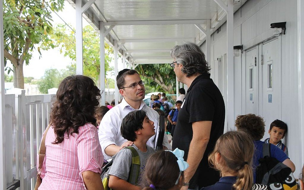 The Ben Gamla Hebrew Charter School in Hollywood, Fla., seen here as a Jewish religious after-school program gets underway, is one sign of the growing presence of young Jewish families in South Florida. (Uriel Heilman/JTA)