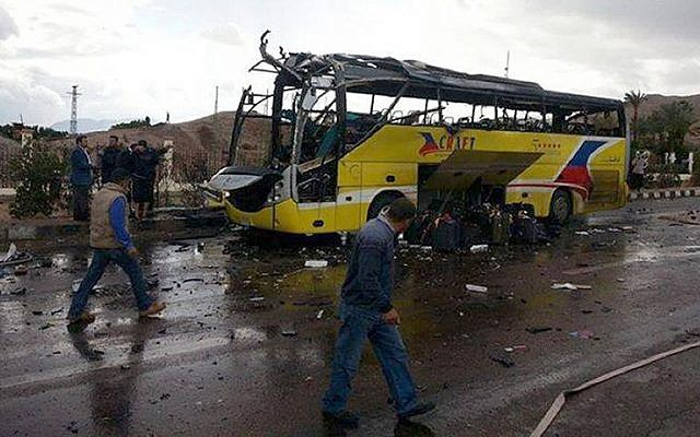 The wreckage of the bus blown up near the Taba crossing on the Egypt-Israel border, February 16, 2014 (photo credit: AFP)