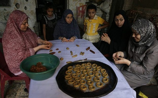 Palestinian women make traditional date-filled cookies in Rafah in the southern Gaza Strip, August 5, 2013 (photo credit: Abed Rahim Khatib/Flash 90)