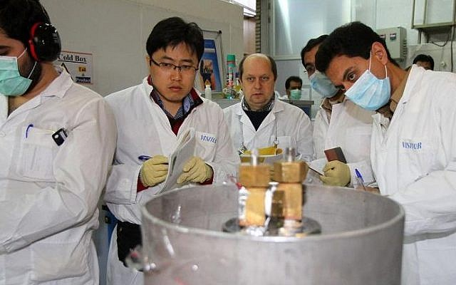 Illustrative. International Atomic Energy Agency inspectors (2nd and 3rd left) and Iranian technicians at Natanz nuclear power plant, south of Tehran, on January 20, 2014. (Kazem Ghane/IRNA/AFP/File)