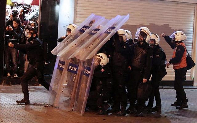 A riot police officer fires rubber bullets to disperse protesters demonstrating against newly proposed restrictions on the use of the internet and against the Turkish government, on the Istiklal Avenue in Istanbul, on January 18, 2014. (photo credit: AFP/FIle)