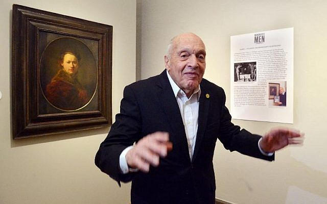 German-born Harry Ettlinger, a Jewish member of the 'Monuments Men,' stands in front of a Rembrandt painting at the art museum Kunsthalle in Karlsruhe, southern Germany on Saturday, February 15, 2014 (photo credit: DPA/AFP Uli Deck)