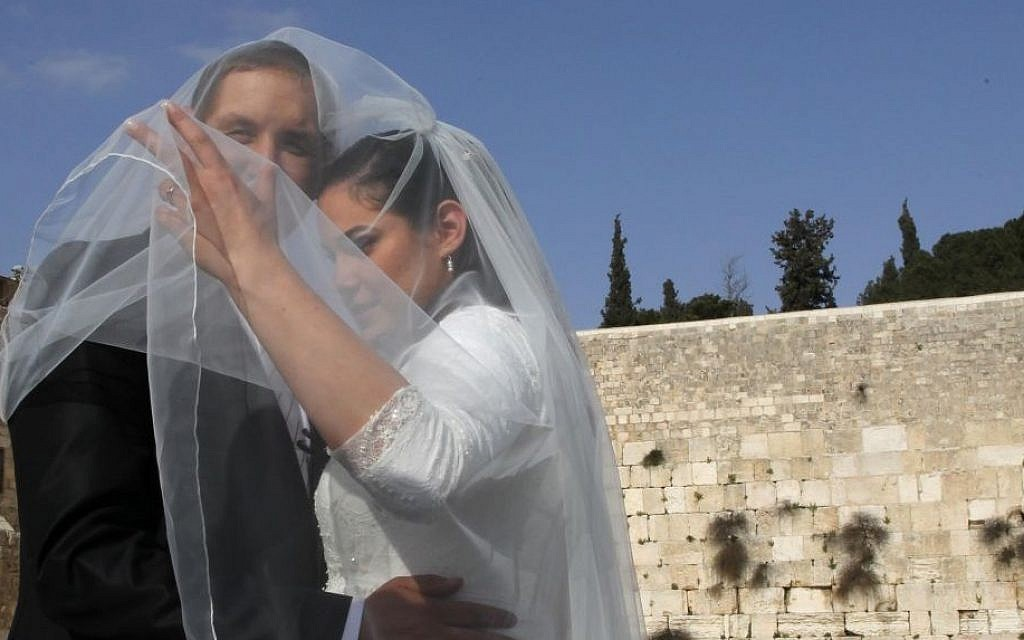 Illustrative photo of a couple having a wedding picture taken at the Western Wall, in the Old City of Jerusalem, April 2011. (Nati Shohat/Flash90)