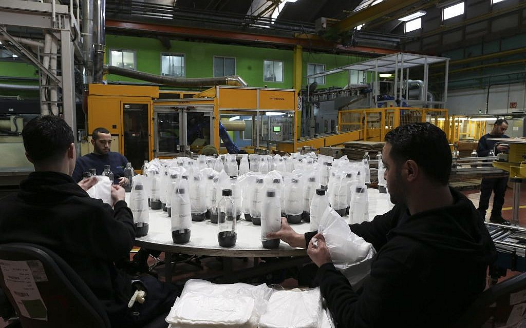 Palestinian employees package bottles at the SodaStream factory, February 2, 2014 (photo credit: Nati Shohat/Flash90)